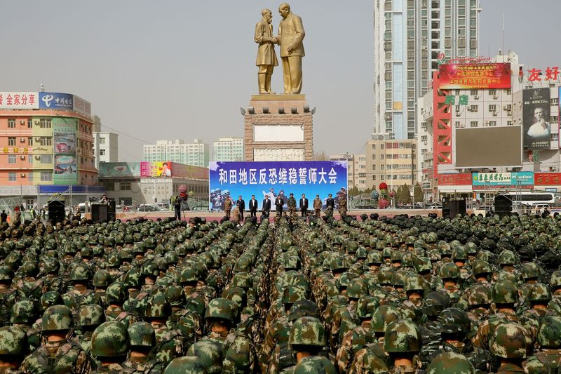 Chinese military police attending an anti-terrorist oath-taking rally in Hetian in Feb. 2017.