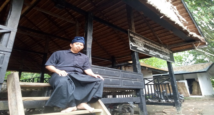 The author at the traditional gate of the Ammatoa Kajang area